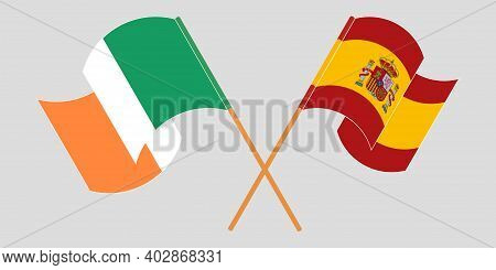 Crossed And Waving Flags Of Ireland And Spain. Vector Illustration