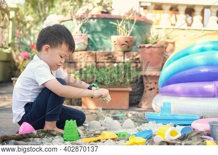 Cute Asian 4 - 5 Years Old Toddler Boy Playing With Sand Alone At Home, Kid Playing With Sand Toys I