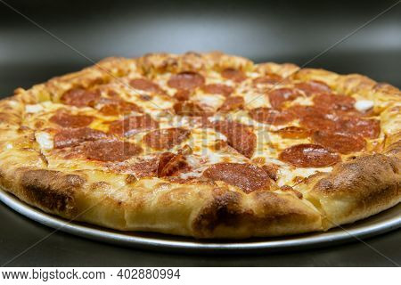 Stuffed Crust Pizza Covered With Pepperoni And Melted Cheese For A Very Hearty Meal.