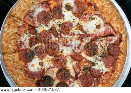 Overhead View Of Cheesy Crust And Extra Cheese Pizza With Pepperoni Meat For This Delicious Meal.