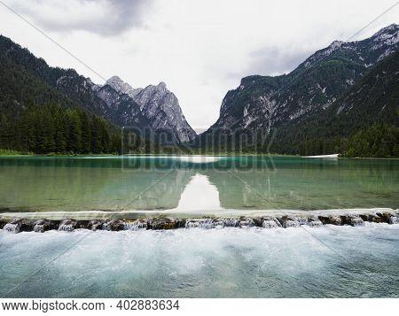 Alpine Mountain Lake Landscape Panorama At Lago Di Dobbiaco Toblacher See In South Tyrol Dolomites A