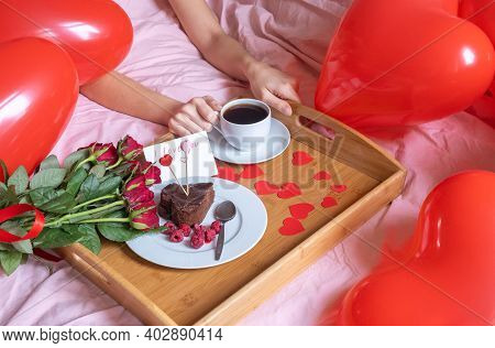 Breakfast For Valentines Day. The Girls Hands Are Holding A Cup Of Coffee. Bouquet Of Roses And Brea