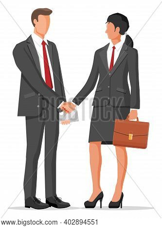 Man And Woman In Business Suits With Case And Laptop Shaking Their Hands. Relations Of Partnership C
