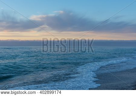 Blue Evening Serene Sea. Calm Seascape In Azure And Pearl Shades. Natural Background In The Twilight