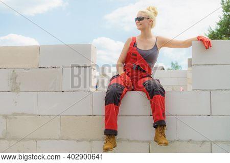 Woman Taking Break On Construction Site