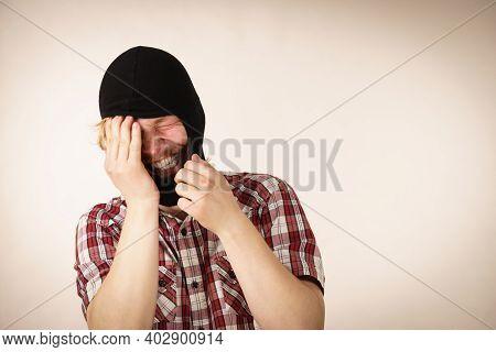 Sad Distraught Thief Wearing Black Balaclava. Tired Man Being Angry At Himslef