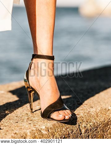 Woman Feet Wearing Fashionable High Heels Summer Shoes.
