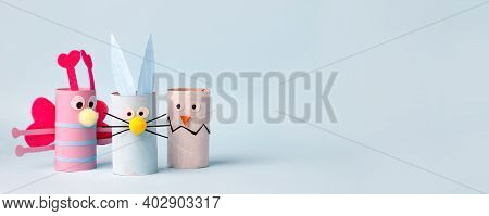 Paper Toy Happy Easter Home Party. Easy Crafts For Kids On Blue Background, Copy Space, Die Creative