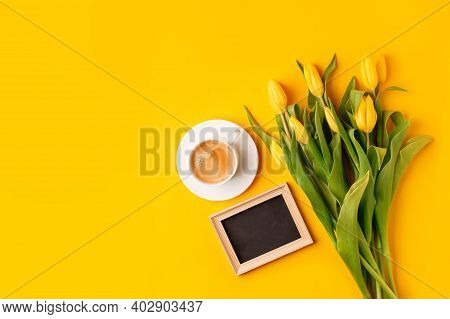 Bright Good Morning Concept - Cup Of Coffee, Frame With Copyspace, Yellow Tulips On Yellow Backgroun