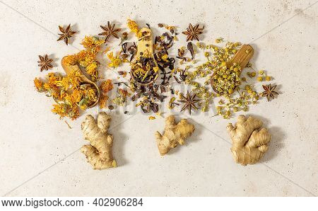 Variety Of Dry Herbal Tea Leaves Scattered Over Wooden Spoons And Ginger. Natural Remedy For Seasona