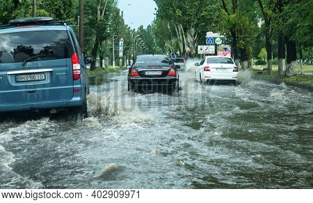 Odessa, Ukraine -august 9,2019: Driving Car On Flooded Road During Flood Caused By Torrential Rains.