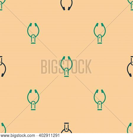 Green And Black Meat Tongs Icon Isolated Seamless Pattern On Beige Background. Bbq Tongs Sign. Barbe