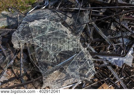 Broken Tempered Window Glass On The Floor. Many Small Cracks On The Surface Of Broken Glass