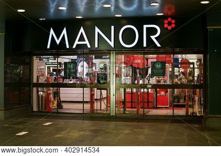 Lugano, Ticino, Switzerland - 5th January 2020 : Manor Department Store Entrance At Night In Lugano.