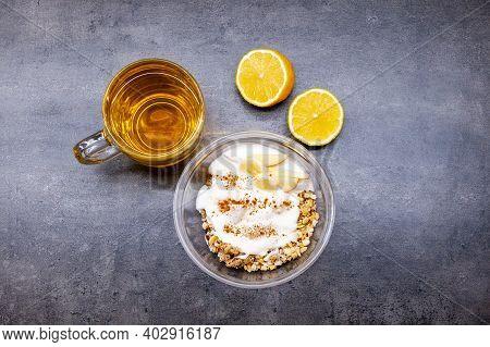 Healthyfood, Granola With Yogurt, Pineaple And Apple, Tea With Lemon. Heathy Breakfast