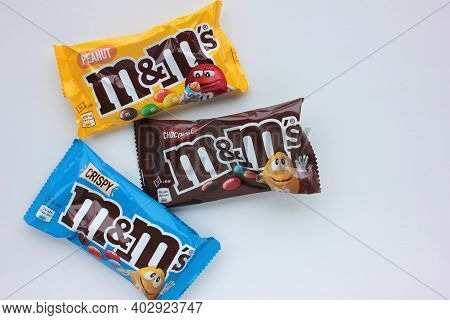 Kyiv - January 12, 2021: Closeup Of M&m's Milk Chocolate Candies Made By Mars Inc. On White Backgrou