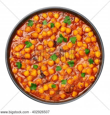 Chana Masala Or Chole In Black Bowl Isolated On White. Indian Cuisine Veg Chickpeas Curry Dish. Asia