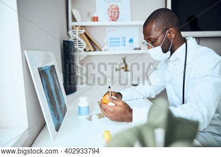 Medic Rewriting The Pills Instructions To A Paper Sheet