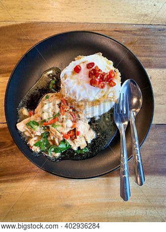 Rice Topped With Stir-fried Chicken And Basil With Fried Egg
