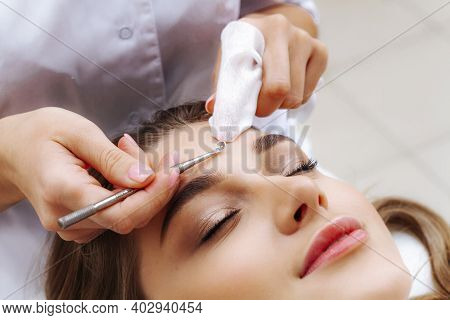 Mechanical Face Cleansing By A Beautician. Problem Skin Treatment. Cosmetologist And Patient.