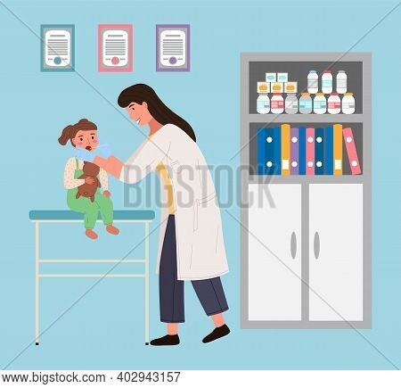 Doctor Examines Child In Hospital. Baby Sits With A Teddy Bear. Pediatrician Examines The Patient S