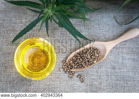Bottle Of Cbd Hemp Oil, Seeds In Wooden Spoons And Tablets Extracted From Hemp Alternative Medicine