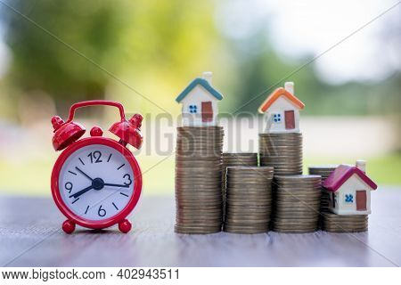 Red Alarm Clock And Coin Ladder House, Financial Ideas, Savings, Investing In Finance, Accounting An