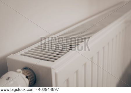 The Battery Is Hanging On The Wall. Heating In An Apartment, At Home. Heating Prices.