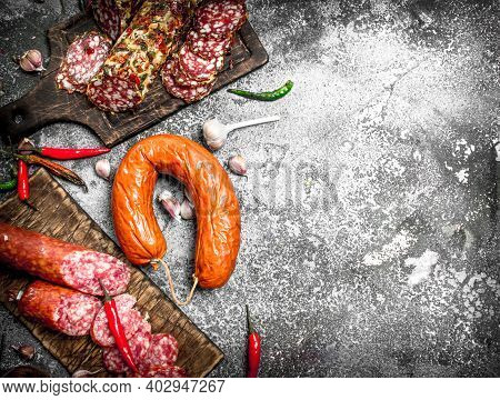 Salami Background. Different Kinds Of Salami With . On A Rustic Background.