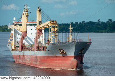 Multipurpose Cargo Ship Underway In The River.