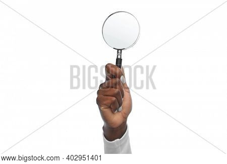 investigation, discovery and search concept - hand with magnifying glass on white background