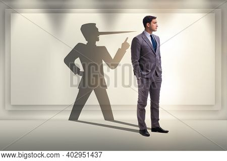 Concept of businessman liar with his shadow