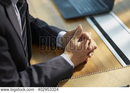 Close-up Shot Of Hands Of An Asian Businessman Contemplating In Office