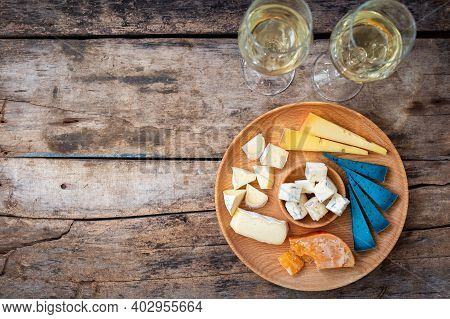 Top View Cheeseboard With Glasses Of Wine On Table
