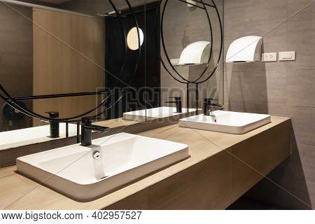 White Ceramic Washbasin In The Interior Of A Modern Bathroom