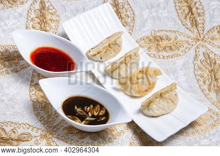 Traditional Homemade Chicken And Vegtables Gyozas With Oriental Soja Souce