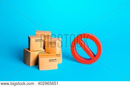 Carton Boxes Of Goods And A Red Prohibition Sign No. Protection Of National Manufacturers. Bureaucra