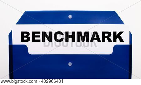 On A White Background, A Blue Folder For Papers. In The Folder Is A Sheet Of Paper With The Words Be