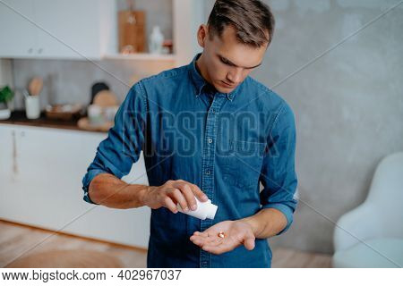 Young Men Taking Pills. Concept Of Health Protection.