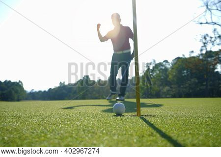 Blurred Golfer Playing Golf In Beautiful Golf Course In The Evening Golf Course With Sunshine In Tha
