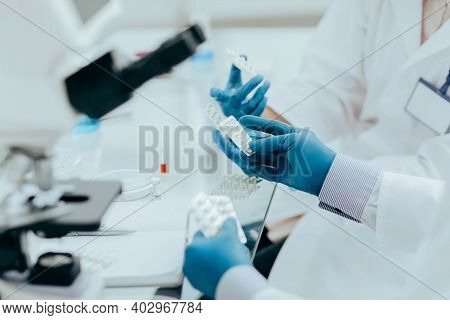 Close Up. Doctors And Pharmacist Discussing A New Drug .