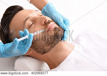 Closeup Of Bearded Man Getting Nasolabial Injection At Aesthetic Clinic, Copy Space. Plastic Surgeon