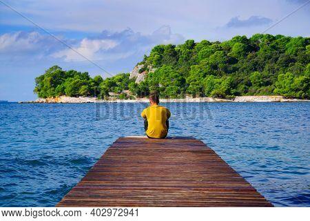 Man on a wooden pier in Rovinj, Croatia, Europe