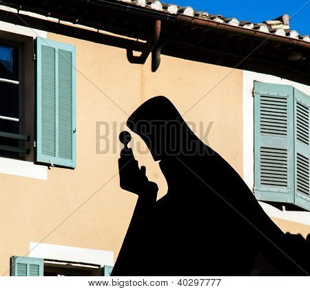 Shadow Of Nostradamus Statue On The Wall