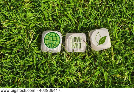 Cubes, Dice Or Blocks With Climate Change In Green Grass