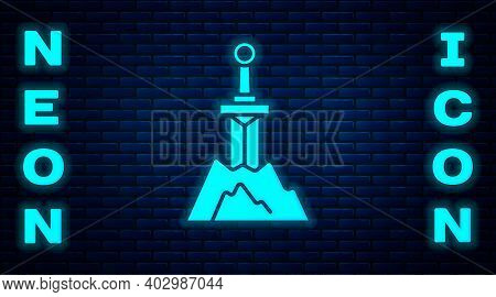 Glowing Neon Sword In The Stone Icon Isolated On Brick Wall Background. Excalibur The Sword In The S