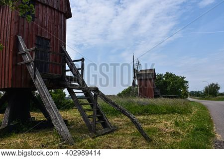 Old Traditional Windmills By Roadside On The Island Oland In Sweden