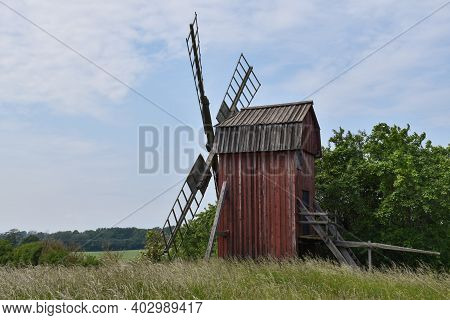 Traditional Old Windmill In A Green Landscape On The Swedish Island Oland