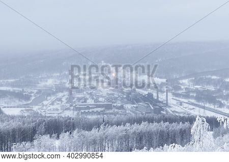 Winter Landscape - A Distant Metallurgical Plant In A Valley In The Middle Of Snow-covered Forests I