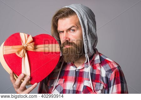Heart Shape Box. Man Holds Valentines Gift Box. Bearded Man Holds Heart Gift Box. Present With Love.